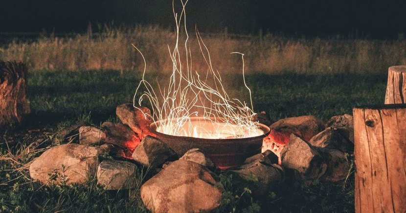 Cropped campfire with tree stump.